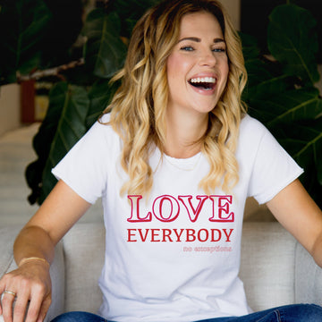 model wearing love everybody ladies tee in ice white