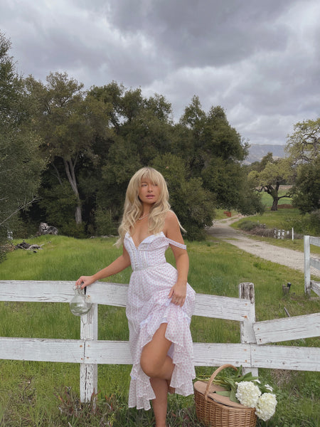 Mina Marlena models the Rosie Dress in the countryside