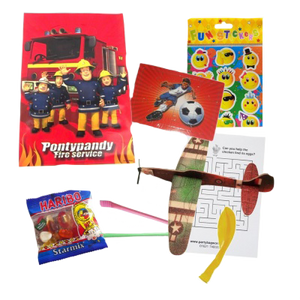 Fireman Sam gift party bag with football jigsaw, emoji stickers, haribo sweets, plane glider, balloons & word search