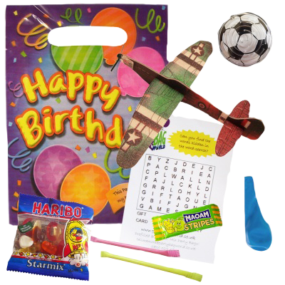 A Happy Birthday party bag with a plane glider, football, balloon, maoam sweet, sugar straws and haribo bag
