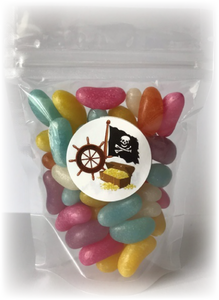 A Pouch full of different coloured jelly beans with a pirate sticker on
