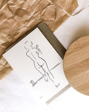 Load image into Gallery viewer, Nude line art drawing by elk draws of woman drinking coffee on 100% recycled paper greeting card