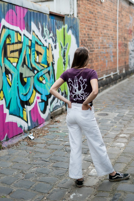 woman in city wearing tshirt with squid on the rear