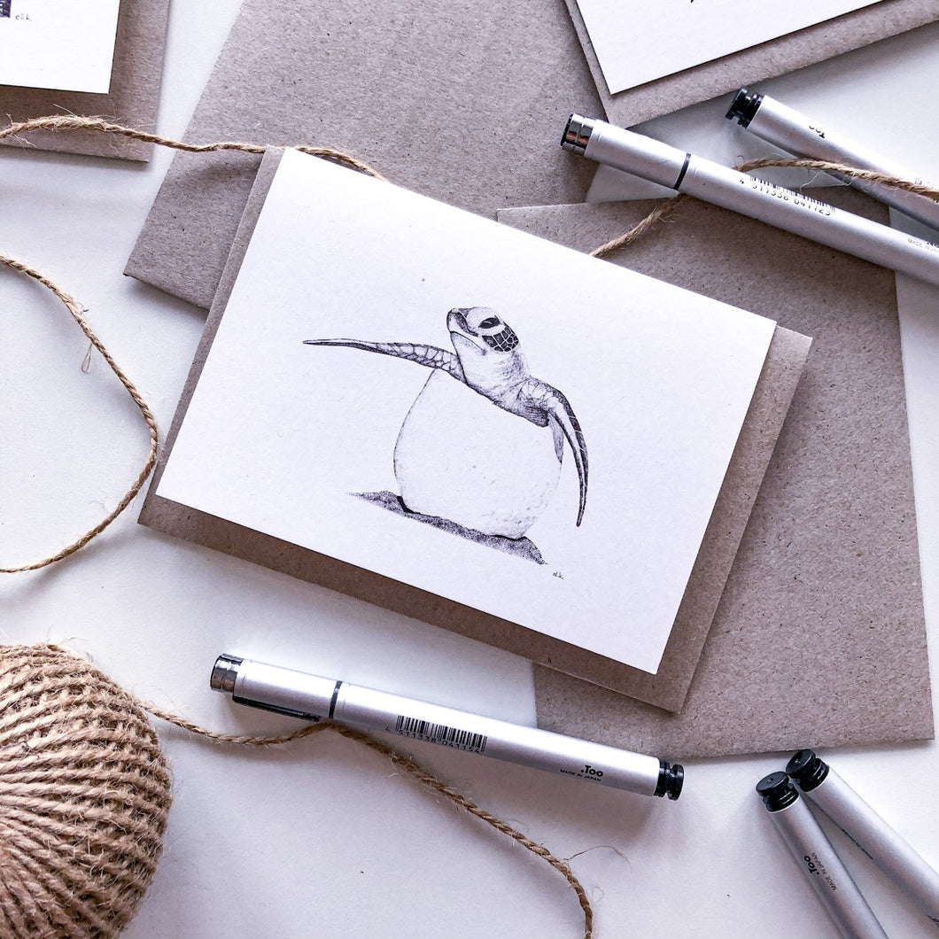 Hand drawn black and white baby turtle greeting card on recycled paperby elk draws