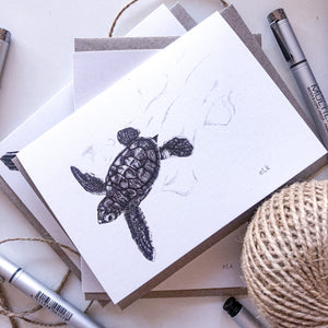 Hand drawn black and white turtle hatchling greeting card by elk draws
