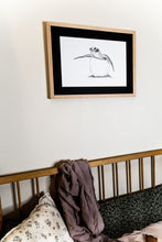 Load image into Gallery viewer, Baby turtle print hanging on wall above cot in nursery