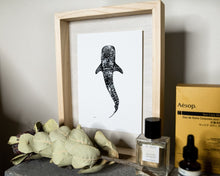Load image into Gallery viewer, black and white whaleshark print by elk draws on bedside table