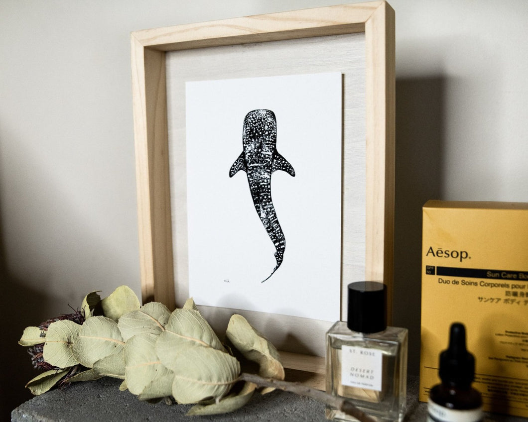 black and white whaleshark print by elk draws on bedside table