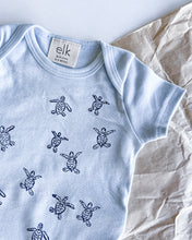 Load image into Gallery viewer, Baby blue organic cotton onesie with turtle hatchlings on it.