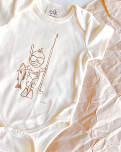 Baby Ecru organic cotton onesie with baby spearo on it.
