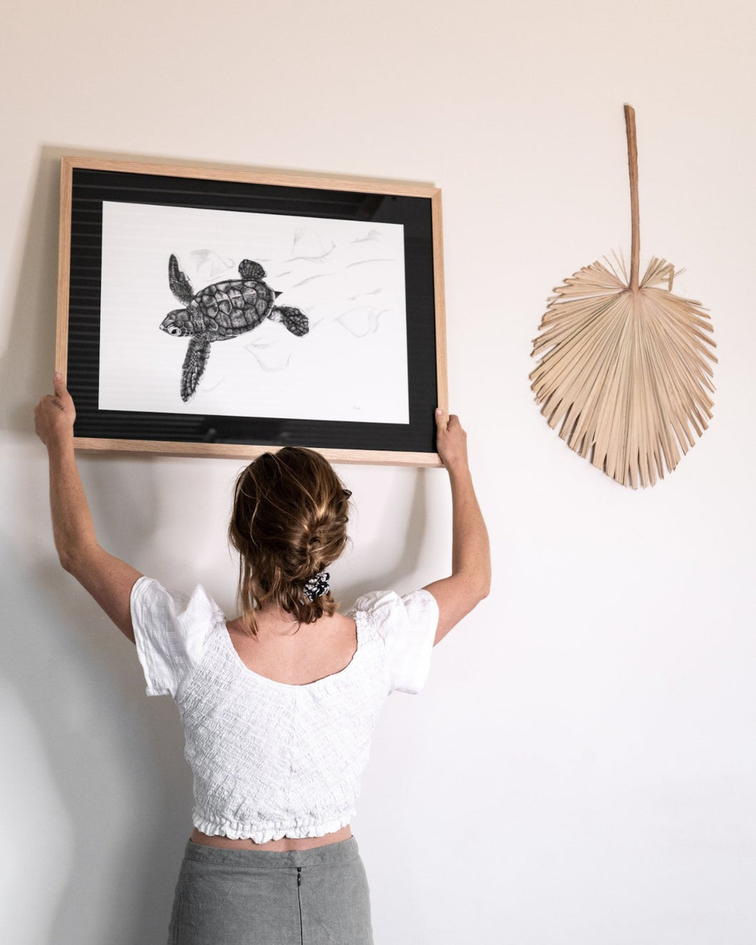 elk draws hanging turtle hatchling limited edition print on white wall