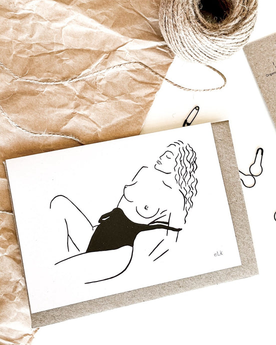 Line art of topless woman at beach in bathing suite on recycled eco friendly green greeting card.