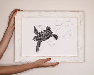 turtle hatchling print by elk draws being held by woman