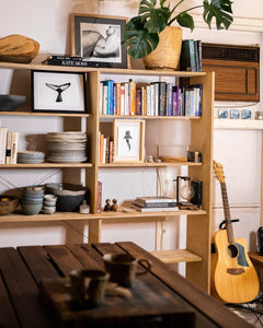 She print with whaleshark with humpback whale fluke print and guitar in open plan kitchen