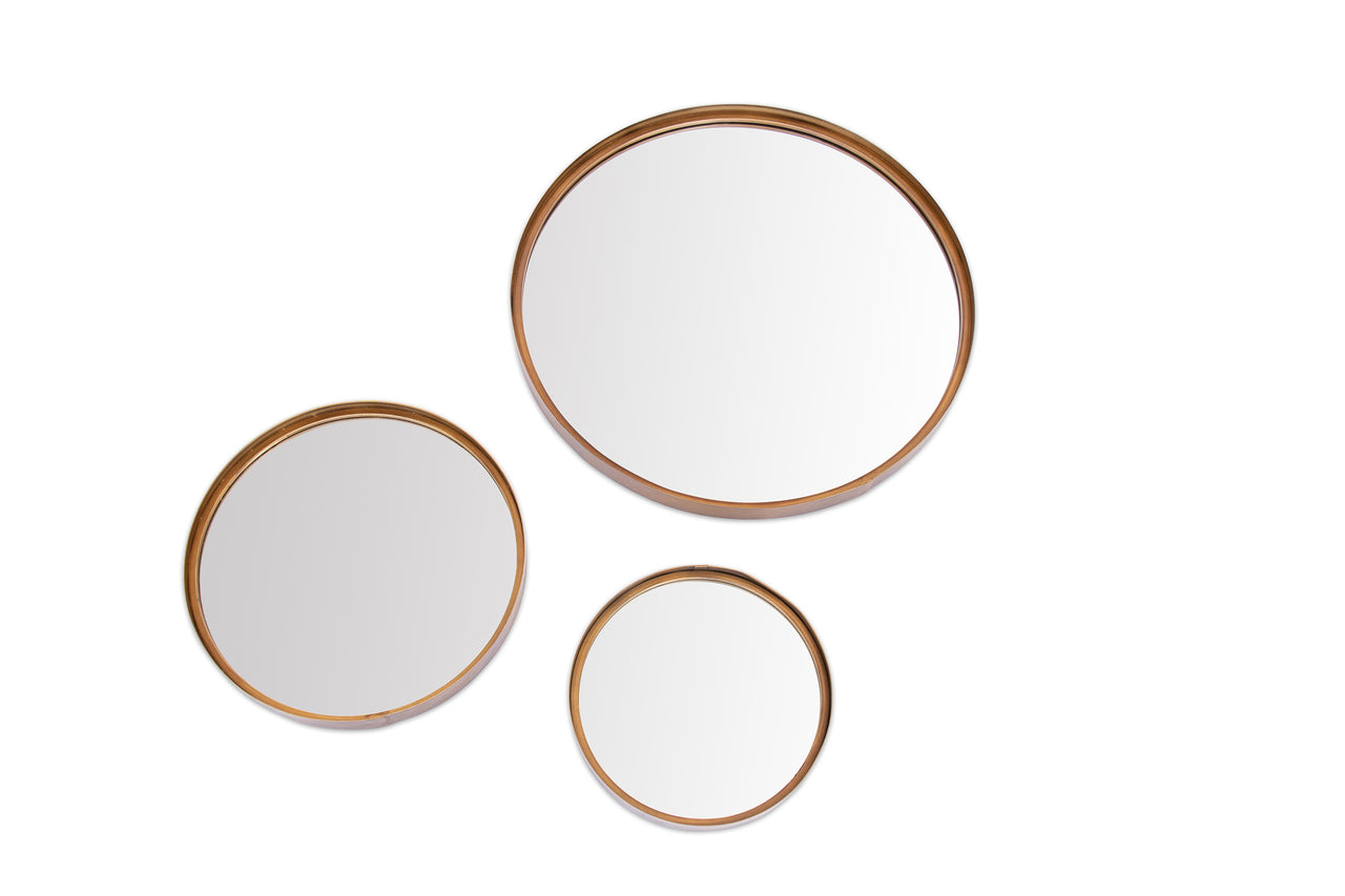 Copper edged round mirror.