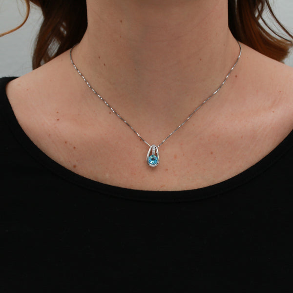 Blue Topaz and Diamonds in White Gold Necklace