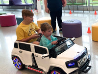 Jr Motors shares the joy of ride-on cars with Children's Hospital NOLA