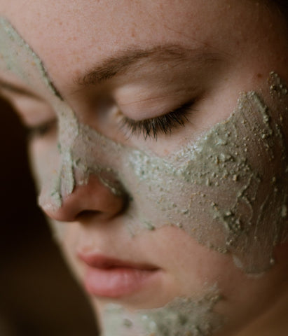 Activated clay mask on face.