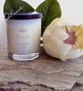 AmbiEscents french pear container candle on rock with flower