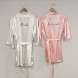 Personalised white bride robe and personalised light pink bridesmaid robe