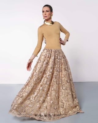 Woman in gold ballroom gown