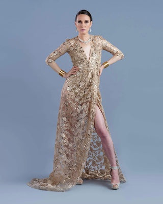 Woman in gold and sequin floor length gown