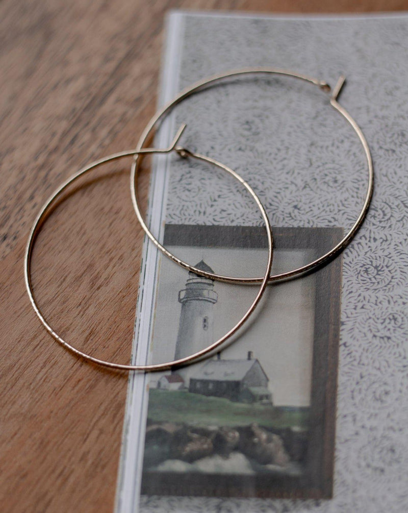 "thin 2"" gold hoop earrings for your core capsule"