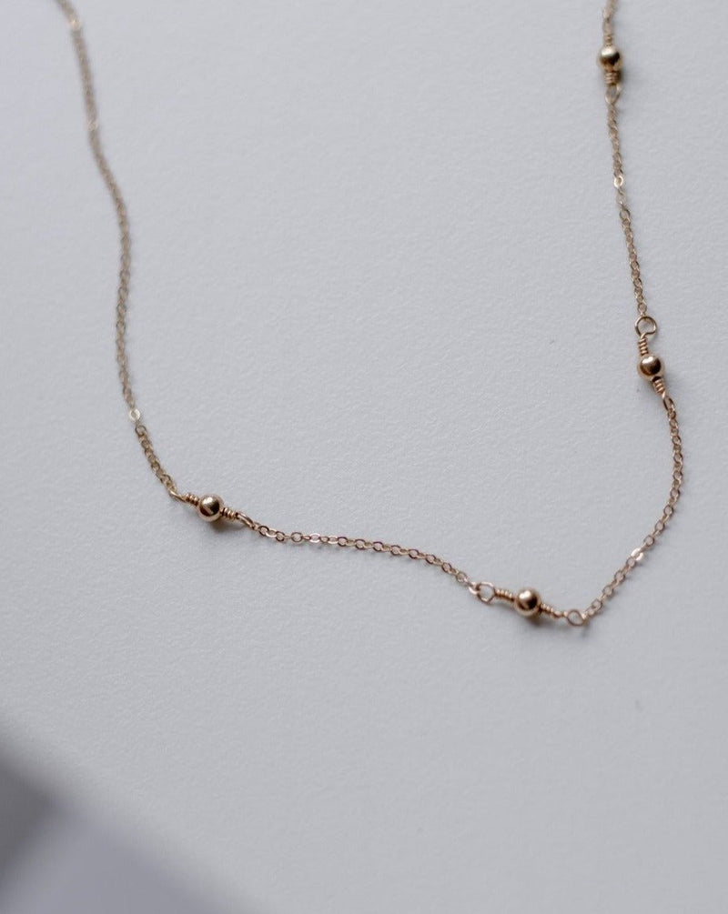 simple gold beaded chain necklace