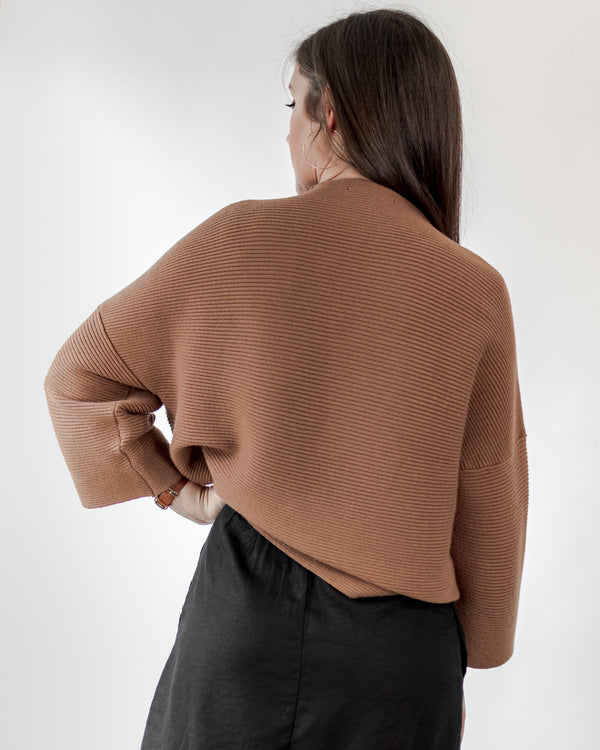 back of a french girl style sweater top in tan