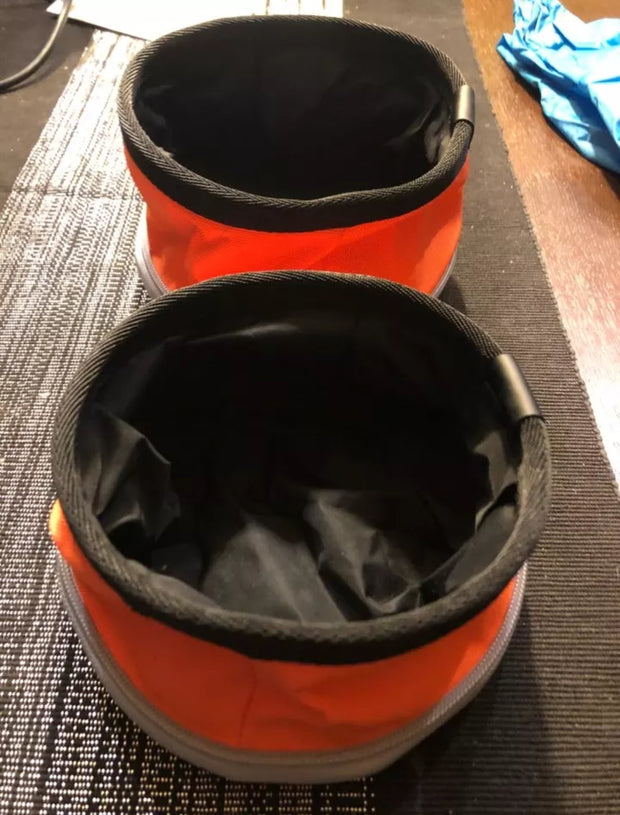 orange foldable food and water travel bowl for dogs open