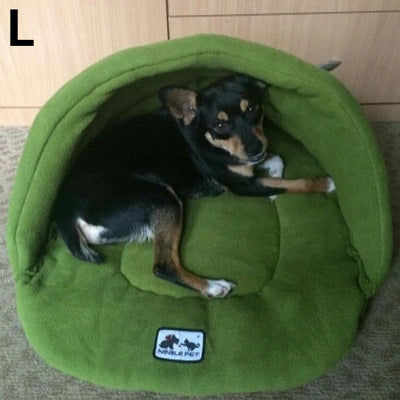 dog inside of green nest bed for dogs