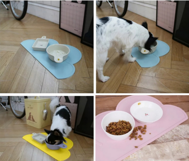 four different cloud shape pet food mats on display for dogs