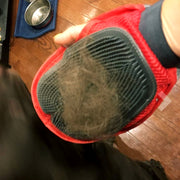 person with multipurpose grooming mitt for dogs covered in hair