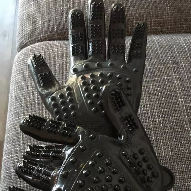 Pair of black grooming massage gloves for dog
