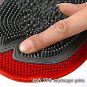 person rubbing finger on multi purpose grooming mitt for dogs