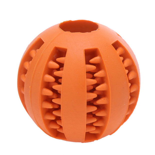 orange teeth cleaning chew ball for dogs holding food