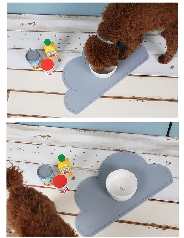 dog drinking from bowl on grey cloud shaped food mat for dogs