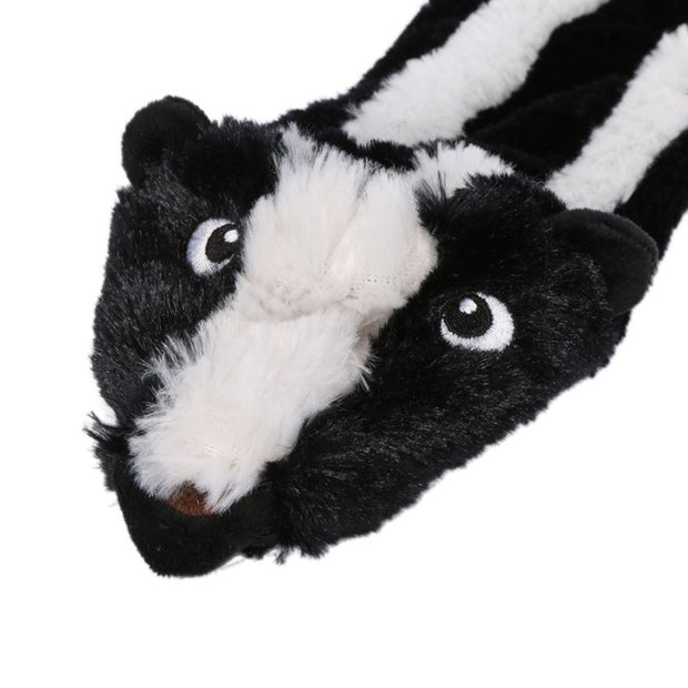 close up of skunk no stuffing dog toy