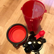 red 2 in 1 food water bottle for dog taken apart