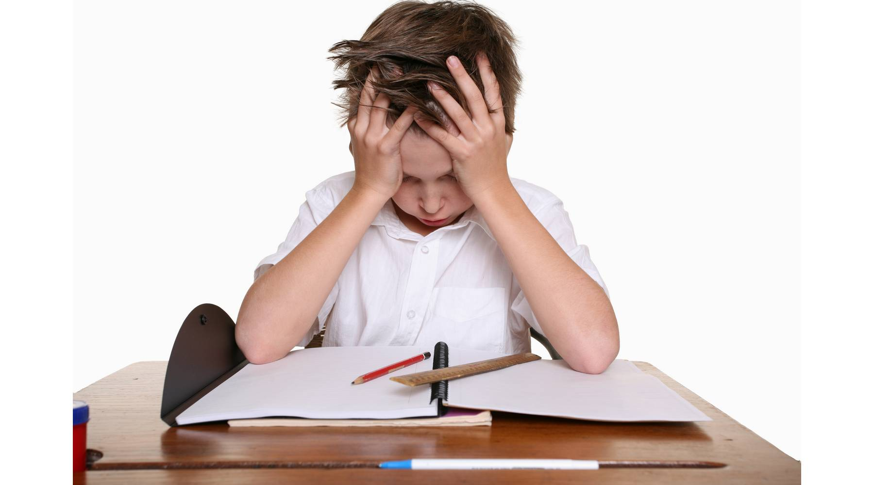 boy at a desk with his head in his hands - frustrated!