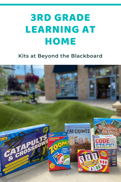 3rd Grade Learning at Home in large turquoise Baloo font, Kits at Beyond the Blackboard in smaller black font, photo of 3rd grade games on a bench, with hub grass and the Beyond the Blackboard storefront in the background