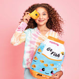 Go Fish Furry and Fleece Pillow; girl with curly hair holding up a plush fish