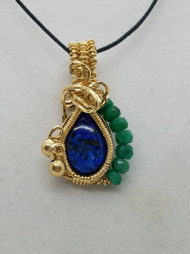 14 kt gold filled wire wrapped Lapis Lazuli and Emerald gemstone pendant.