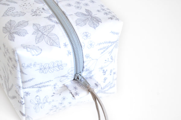 White Floral Laminated Toiletry Bag