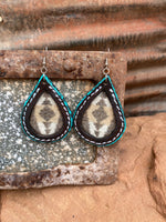 Pendleton inlay earrings with turquoise edges.