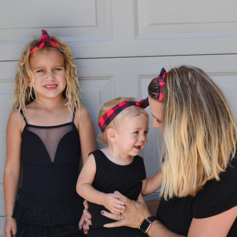 mom and girls wearing plaid knotted