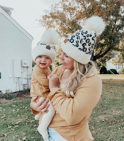mom and baby in beanies