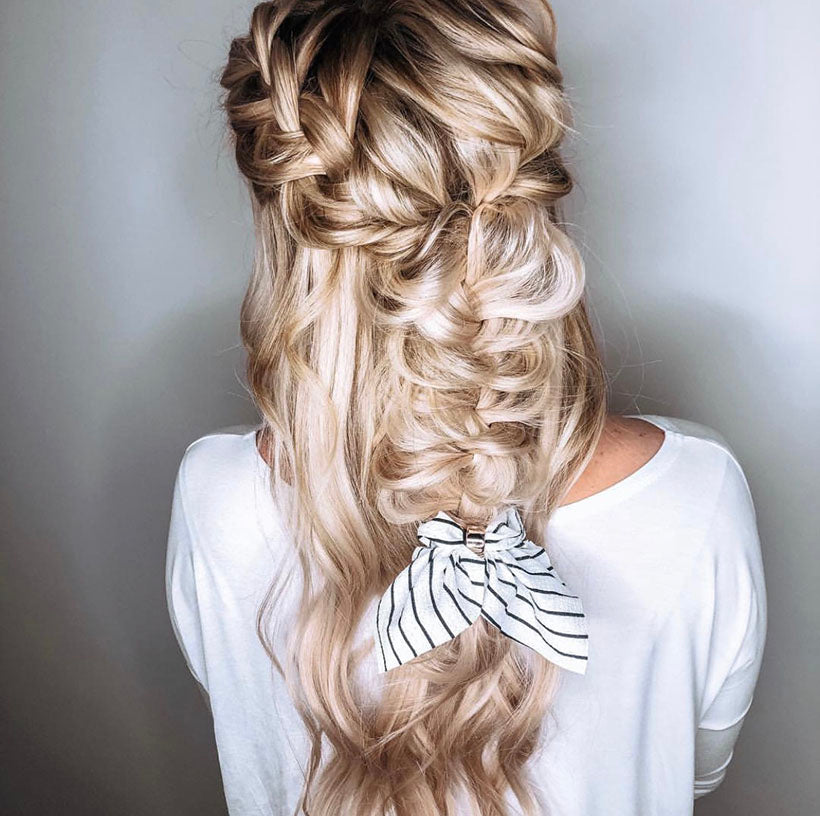 messy fishtail braid with bow clip