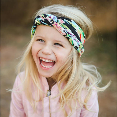 girl wearing black floral baby turban