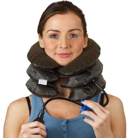 Woman wearing a neck pillow for support